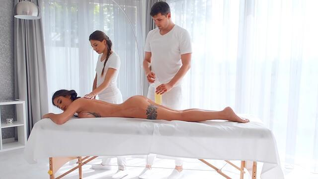 the man doing the massage is stroking the hips